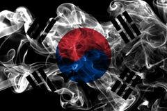 South Korea smoke flag on a black background.  royalty free stock photography