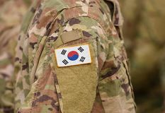 South Korea on soldiers arm collage. South Korea flag on soldiers arm collage stock images