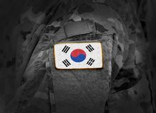 South Korea on soldiers arm collage royalty free stock image
