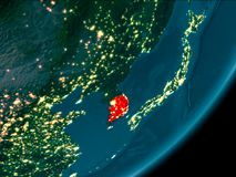 South Korea from space at night. Night view of South Korea highlighted in red on planet Earth with atmosphere. 3D illustration. Elements of this image furnished Royalty Free Stock Image