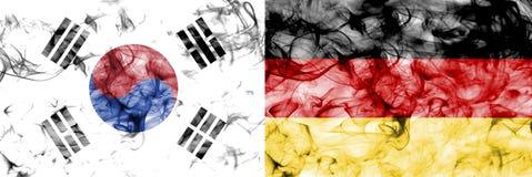 South Korea vs Germany smoke flag. Isolated on a white background stock photo