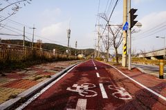 South Korea Winter Red Run Down Bicycle Lane Incheon stock photography
