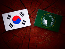 South Korean flag with African Union flag on a tree stump isolat Royalty Free Stock Photos