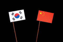 South Korean flag with Chinese flag on black. Background stock image