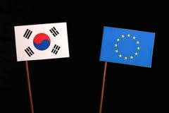 South Korean flag with European Union EU flag isolated on black. Background Stock Photography