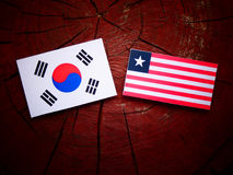 South Korean flag with Liberian flag on a tree stump isolated Royalty Free Stock Image