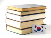 South Korean flag with pile of books isolated on white backgroun stock photography