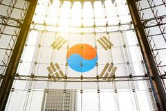 South Korean flag streched on a glass wall with sun flare visible Royalty Free Stock Photography