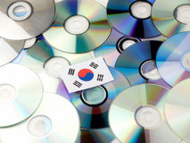 South Korean flag on top of CD and DVD pile isolated on white. South Korean flag on top of CD and DVD pile isolated Stock Photography