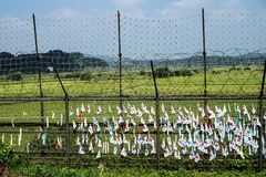 South korean flags at a fence at the demilitarised zone DMZ at the freedom bridge, South Korea, Asia Stock Image