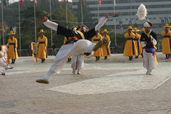 South Korean Hat dancers. Perform at the War Memorial of Korea. A performer is shown in mid air with musicians in traditional costume in the background Stock Images