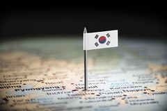 South Korean marked with a flag on the map.  royalty free stock photos