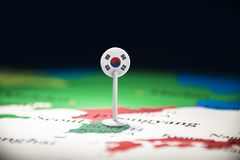 South Korean marked with a flag on the map.  stock images