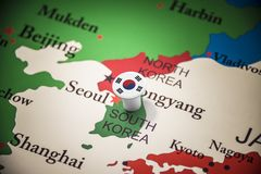 South Korean marked with a flag on the map.  stock photo