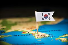 South Korean marked with a flag on the map.  stock image