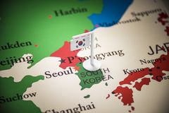 South Korean marked with a flag on the map.  royalty free stock images