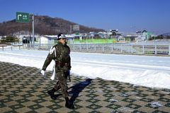 South Korean Soldier walking near the border of North Korea Stock Photo