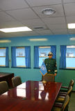 South Korean soldiers on the border at Panmunjom. South Korean elite soldier standing guard at the meeting table which is astride the border between North and Stock Photo