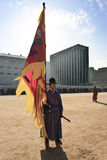 South Korean soldiers in traditional dress. Gyeongbokgung Palace, a South Korean front of soldiers in traditional dress holding a banner, the ongoing parade of Royalty Free Stock Images