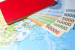 South Korean Won currency on map with passport Stock Images