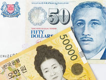 50000 South Korean won and 50 Singapore dollar Royalty Free Stock Photo