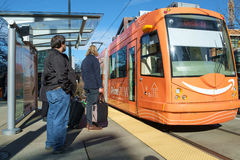 South Lake Union Trolley. Seattle, WA, USA Feb. 17, 2017: Riders prepare to board an orange colored South Lake Union Trolley on a sunny winter day in Seattle Royalty Free Stock Photos