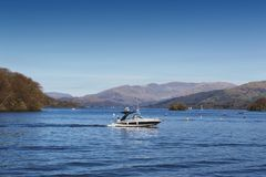 Scenic lake cruise by a motorboat on Lake Windermere in Lake District National Park, North West England, UK. South Lakeland, UK - April 2018: Scenic lake cruise stock photography