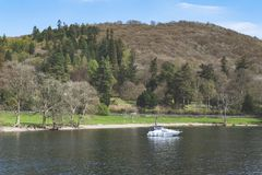 Scenic lake cruise by a motorboat on Lake Windermere in Lake District National Park, North West England, UK. South Lakeland, UK - April 2018: Scenic lake cruise stock images