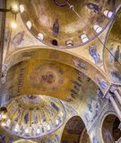 The ceiling mosaics of the South Leonard`s Cupola inside St. Mark`s Basilcia. Stock Photo