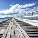 South Molle Island Jetty. Jetty photo with blue sky and clouds abstract Royalty Free Stock Photos