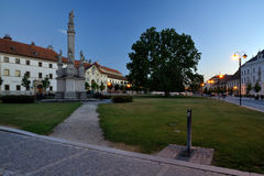 South Moravia, Valtice, square with a statue. Evening in UNESCO town Valtice with water tap, statue and tree Stock Images