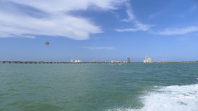 South Padre Island and parasail. The skyline of South Padre Island, Texas, with a parasail and the Queen Isabella Causeway Stock Photography