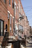 South Philly Row Houses. A row of typical two story brick homes in South Philly neighborhood of Philadelphia Pennsylvania Stock Photo