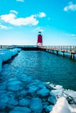 Small icebergs melting at the South Pier Lighthouse off of Lake Michigan in Charlevoix Michigan stock photos