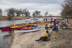 Paddling lunch break. SOUTH PLATTE RIVER, EVANS, COLORADO - APRIL 6: Paddlers are taking a lunch break during Annual All Club Paddle on April 6, 2013. It is a Stock Photos