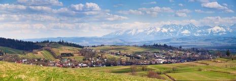 South Poland Panorama with snowy Tatra mountains in spring. South Poland (Malopolska) Panorama with snowy Tatra mountains in spring Stock Photo