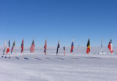 South Pole Flags. The Ceremonial South Pole is located near the Geographic South Pole. The flags of the original signatory nations to the Antarctic Treaty royalty free stock photos