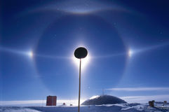 South Pole Halo. A rare halo display at the South Pole, Antarctica. The extreme cold temperatures and unusual atmospheric conditions result in atmospheric Stock Photo