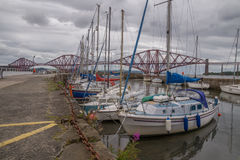 The South Queensferry marina in front of the Forth Bridge, Scotland Royalty Free Stock Photos