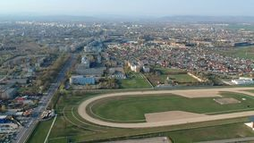 The south side of Ploiesti City, Romania near the horse track, aerial footage. Panoramic view of the south side of Ploiesti City , Romania, in the foreground the stock video footage