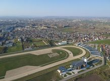 The south side of Ploiesti City, Romania near the horse track, aerial view. Panoramic view of the south side of Ploiesti City , Romania, in the foreground the royalty free stock images