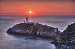 South Stack Lighthouse. And island at sunset Stock Photography