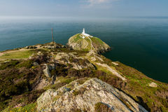 South Stack lighthouse, Anglesey. View down on South Stack light house on sunny morning. Anglesey, North Wales, United Kingdom Royalty Free Stock Photos