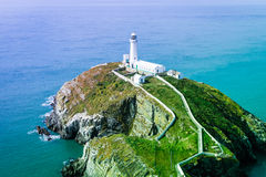South stack lighthouse with thin rainbow layer Royalty Free Stock Images