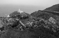 South Stacks Lighthouse. The historic South Stack Lighthouse is located on a small island reached via a descent of 400 steps down the steep mainland cliffs Royalty Free Stock Images