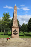 South Staffordshire, National Memorial Arboretum. Sandstone needle shaped monument for South Staffordshire regiment at the National Memorail Arboretum at Alrewas Stock Photography