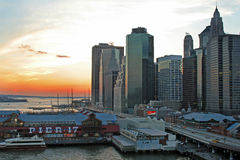 South Street Seaport. Southern Manhattan at sunset from brooklyn bridge royalty free stock photography