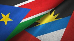 South Sudan and Antigua and Barbuda two flags textile cloth, fabric texture. South Sudan and Antigua and Barbuda two folded flags together royalty free stock photo