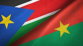 South Sudan and Burkina Faso two flags textile cloth, fabric texture. South Sudan and Burkina Faso two folded flags together royalty free stock photos