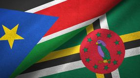 South Sudan and Dominica two flags textile cloth, fabric texture. South Sudan and Dominica two folded flags together royalty free stock image